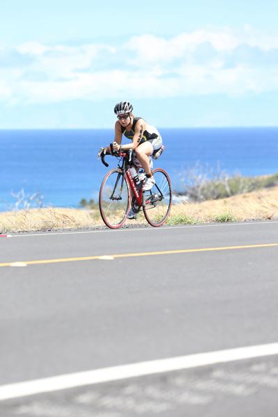 Erin Easingwood cycling in triathlon
